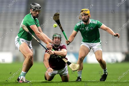 Limerick vs Galway. Galway's Fintan Burke with Gearoid Hegarty and Tom Morrissey of Limerick