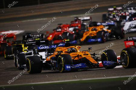 Lando Norris, McLaren MCL35, leads Pierre Gasly, AlphaTauri AT01 during the 2020 Formula One Bahrain Grand Prix