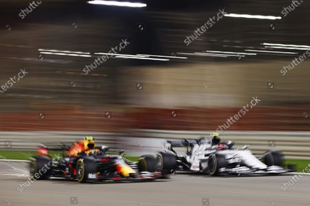 Pierre Gasly, AlphaTauri AT01, battles with Alexander Albon, Red Bull Racing RB16 during the 2020 Formula One Bahrain Grand Prix