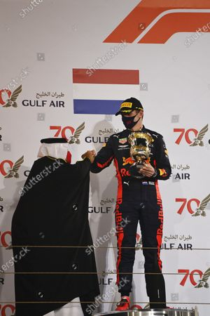 Abdullah bin Hamad bin Isa Al Khalifa presents Max Verstappen, Red Bull Racing, 2nd position, with his trophy during the 2020 Formula One Bahrain Grand Prix