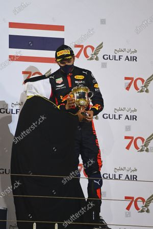 Abdullah bin Hamad bin Isa Al Khalifa presents Alexander Albon, Red Bull Racing, 3rd position, with his trophy during the 2020 Formula One Bahrain Grand Prix