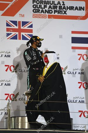 Abdullah bin Hamad bin Isa Al Khalifa presents the trophies on the podium during the 2020 Formula One Bahrain Grand Prix