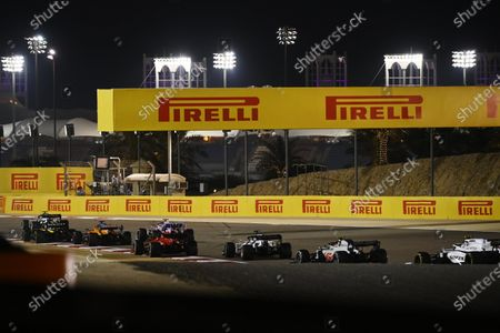 Nicholas Latifi, Williams FW43, chases Kevin Magnussen, Haas VF-20, Daniil Kvyat, AlphaTauri AT01 and Sebastian Vettel, Ferrari SF1000 and Lance Stroll, Racing Point RP20  during the 2020 Formula One Bahrain Grand Prix