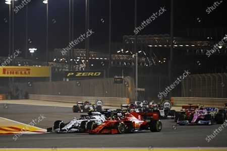 Stock Photo of Pierre Gasly, AlphaTauri AT01, battles Charles Leclerc, Ferrari SF1000, and the rest of the pack during the 2020 Formula One Bahrain Grand Prix