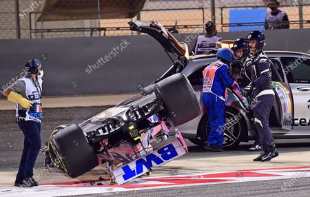 Stock Picture of Marshals place Racing Point driver Lance Stroll into a safety car after an accident during the Formula One Bahrain Grand Prix in Sakhir, Bahrain