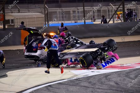 Marshals secure Racing Point driver Lance Stroll's car after an accident during the Formula One Bahrain Grand Prix in Sakhir, Bahrain