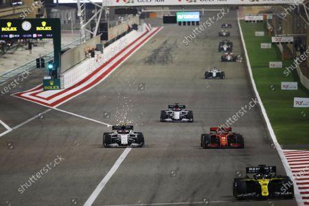 Sparks fly as Pierre Gasly, AlphaTauri AT01, battles with Charles Leclerc, Ferrari SF1000, ahead of Daniil Kvyat, AlphaTauri AT01 during the 2020 Formula One Bahrain Grand Prix