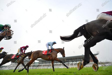 Stock Image of FAIRYHOUSE 29-November-2020. The Baroneracing.com Hatton's Grace Hurdle (Grade 1) HONEYSUCKLE and Rachael Blackmore, centre ,passing the enclosures on the 1st circut to go on and win for owner Kenneth Alexander and trainer Henry de Bromhead. Healy Racing