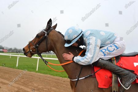FAIRYHOUSE 29-November-2020. The Baroneracing.com Hatton's Grace Hurdle (Grade 1) HONEYSUCKLE gets a kiss from Rachael Blackmore after win for owner Kenneth Alexander and trainer Henry de Bromhead. Healy Racing