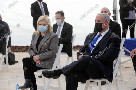 Israeli Prime Minister Benjamin Netanyahu (R) with his wife Sara Netanyahu (L) attend opening ceremony for Sha'ar Hagai National site, near Jerusalem, Israel, 29 November 2020. The Khan Sha'ar HaGai national site is dedicated to the memory of fighters of the besieged road to Jerusalem during the 1948 Arab-Israeli War.