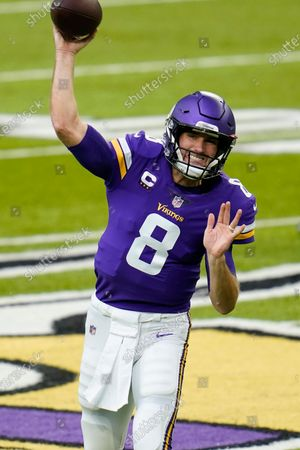 Stock Picture of Minnesota Vikings quarterback Kirk Cousins warms up before an NFL football game against the Carolina Panthers, in Minneapolis