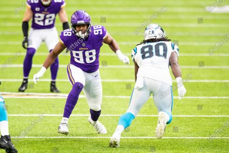 Minnesota Vikings defensive end D.J. Wonnum (98) in action against Carolina Panthers tight end Ian Thomas (80) in the first quarter during an NFL football game, in Minneapolis. The Vikings defeated the Panthers 28-27