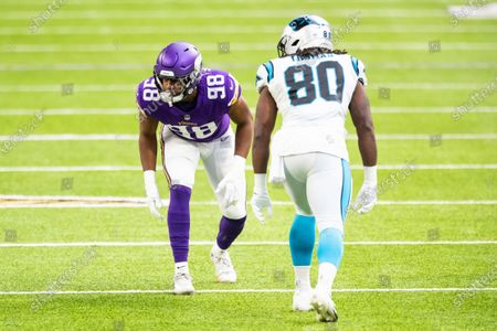 Minnesota Vikings defensive end D.J. Wonnum (98) readies for the play against Carolina Panthers tight end Ian Thomas (80) in the first quarter during an NFL football game, in Minneapolis. The Vikings defeated the Panthers 28-27