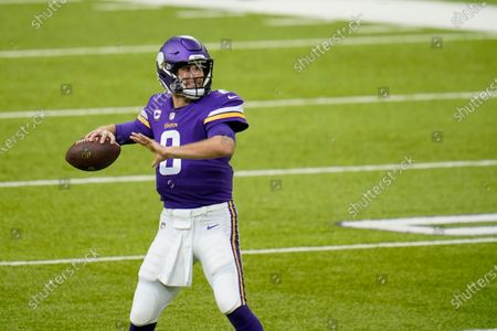 Minnesota Vikings quarterback Kirk Cousins warms up before an NFL football game against the Carolina Panthers, in Minneapolis