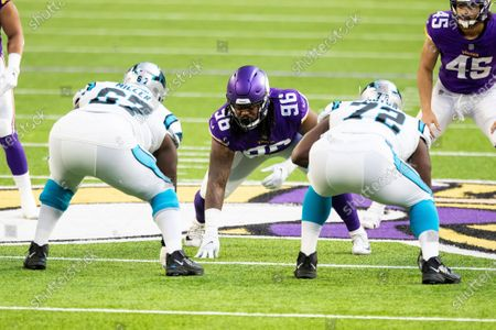 Minnesota Vikings defensive tackle Armon Watts (96) readies at the line of scrimmage against Carolina Panthers offensive guard John Miller (67) and offensive tackle Taylor Moton (72) in the first quarter during an NFL football game, in Minneapolis. The Vikings defeated the Panthers 28-27