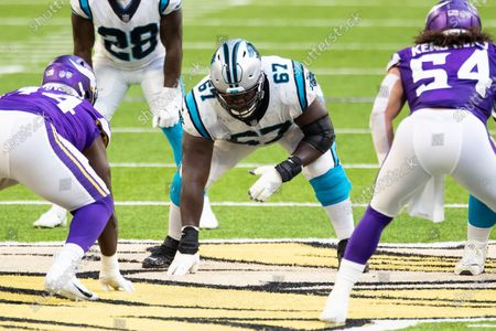 Carolina Panthers offensive guard John Miller (67) readies at the line of scrimmage in the second quarter during an NFL football game against the Minnesota Vikings, in Minneapolis. The Vikings defeated the Panthers 28-27