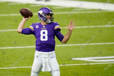 Stock Image of Minnesota Vikings quarterback Kirk Cousins warms up before an NFL football game against the Carolina Panthers, in Minneapolis