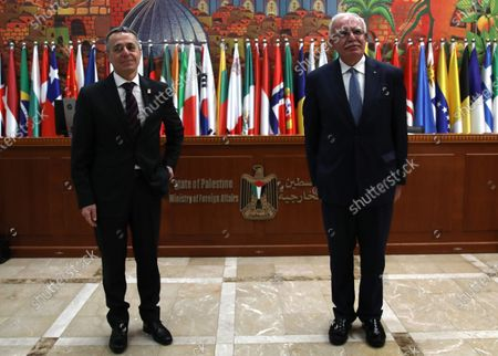 Swiss Federal Councilor Ignazio Cassis (L) and Palestinian Foreign Minister Riyad Al-Maliki (R) prio their meeting in the West Bank city of Ramallah, 29 November 2020. Cassis is on a visit to Ramallah and Jerusalem.