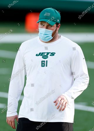 Stock Picture of New York Jets center James Murray (61) warms up before taking on the Miami Dolphins in an NFL football game, in East Rutherford, N.J