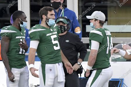 New York Jets quarterbacks Joe Flacco (5) and Sam Darnold (14) talk on the sidelines during the second half of an NFL football game against the Miami Dolphins, in East Rutherford, N.J