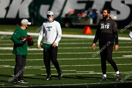 Stock Photo of New York Jets quarterback Sam Darnold (14) and New York Jets quarterback Joe Flacco (5) warm up before taking on the Miami Dolphins in an NFL football game, in East Rutherford, N.J