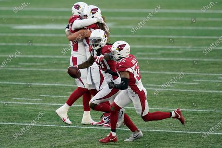 Arizona Cardinals cornerback Dre Kirkpatrick, center, celebrates his interception with teammates in the second half of an NFL football game against the New England Patriots, in Foxborough, Mass