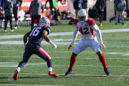 Stock Image of Arizona Cardinals linebacker Devon Kennard (42) defends New England Patriots wide receiver Jakobi Meyers (16) during the first half of an NFL football game, in Foxborough, Mass