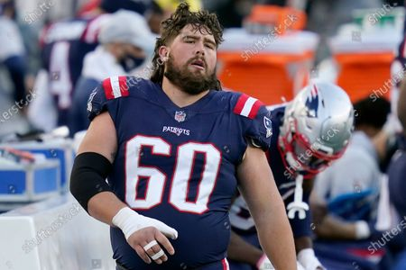 New England Patriots center David Andrews watches from the sideline in the second half of an NFL football game against the Arizona Cardinals, in Foxborough, Mass
