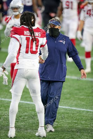 New England Patriots head coach Bill Belichick shakes hands with Arizona Cardinals wide receiver DeAndre Hopkins (10) following an NFL football game, in Foxborough, Mass