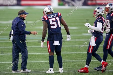 New England Patriots head coach Bill Belichick talks with linebacker Ja'Whaun Bentley (51) during the second half of an NFL football game against the Arizona Cardinals, in Foxborough, Mass