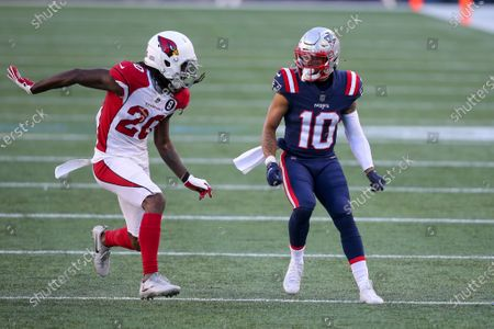 Arizona Cardinals cornerback Dre Kirkpatrick (20) defends New England Patriots wide receiver Damiere Byrd (10) during the second half of an NFL football game, in Foxborough, Mass