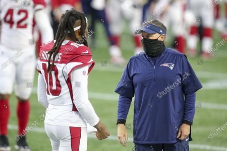 Stock Image of New England Patriots head coach Bill Belichick talks with Arizona Cardinals wide receiver DeAndre Hopkins (10) following an NFL football game, in Foxborough, Mass