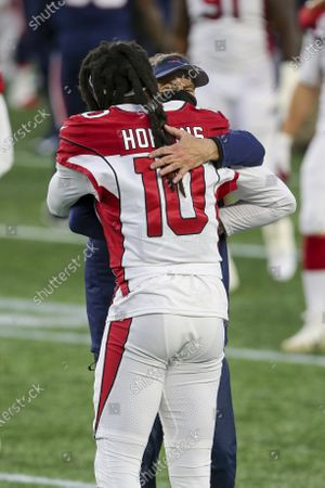 New England Patriots head coach Bill Belichick hugs with Arizona Cardinals wide receiver DeAndre Hopkins (10) following an NFL football game, in Foxborough, Mass