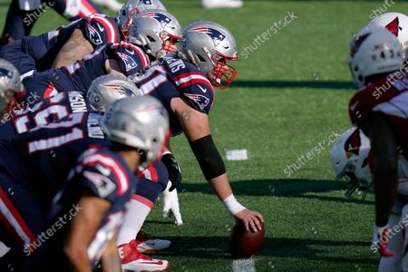New England Patriots center David Andrews prepares to center the ball as the team faces off at the line of scrimmage against the Arizona Cardinals in the first half of an NFL football game, in Foxborough, Mass
