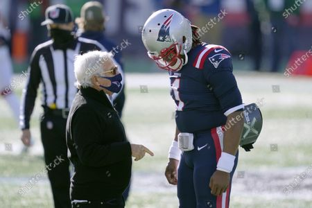 New England Patriots owner Robert Kraft, left, speaks with quarterback Cam Newton before an NFL football game against the Arizona Cardinals, in Foxborough, Mass