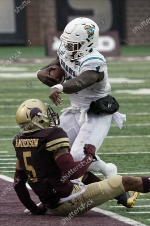 Stock Picture of Coastal Carolina's CJ Marable (1) is tackled by Texas State's Kevin Anderson (5) during the first half of an NCAA college football game in San Marcos, Texas
