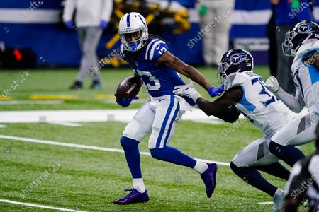 Indianapolis Colts wide receiver T.Y. Hilton (13) is tackled by Tennessee Titans defensive back Chris Jackson (35) in the second half of an NFL football game in Indianapolis