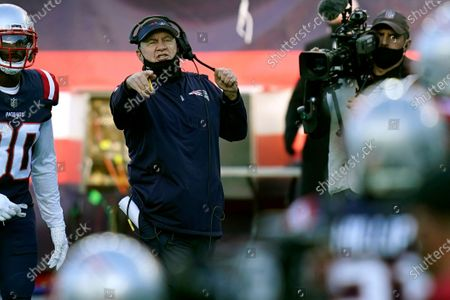 Stock Photo of New England Patriots head coach Bill Belichick gestures from the sideline in the first half of an NFL football game against the Arizona Cardinals, in Foxborough, Mass