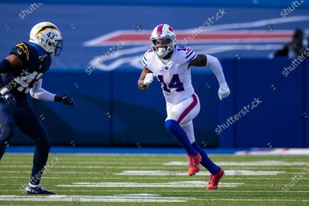 Buffalo Bills wide receiver Stefon Diggs (14) runs a pass route against Los Angeles Chargers cornerback Michael Davis (43) during the first quarter of an NFL football game, in Orchard Park, N.Y