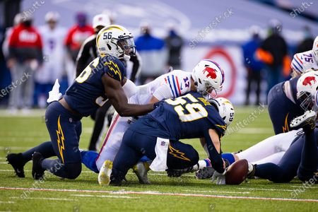 Buffalo Bills quarterback Josh Allen (17) dives towards a fumbled snap as Los Angeles Chargers outside linebacker Kenneth Murray (56) and outside linebacker Nick Vigil (59) also dive for the ball during the fourth quarter of an NFL football game, in Orchard Park, N.Y