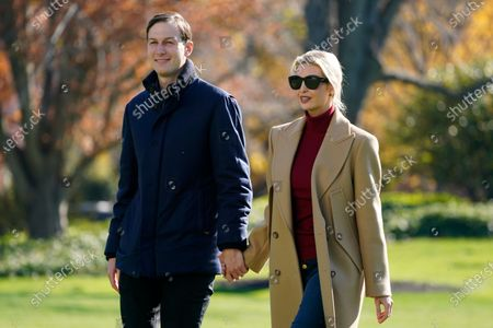 President Donald Trump's White House Senior Adviser Jared Kushner and Ivanka Trump, the daughter of President Trump, walk on the South Lawn of the White House in Washington, after stepping off Marine One after returning from Camp David
