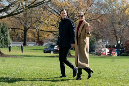 President Donald Trump's White House Senior Adviser Jared Kushner and Ivanka Trump, the daughter of President Trump, walk on the South Lawn of the White House in Washington, after stepping off Marine One upon returning from Camp David