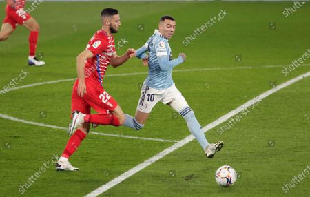 Stock Image of Celta Vigo's Iago Aspas (R) in action against Granada's Domingos Duarte (L) during the Spanish La Liga soccer match between Celta Vigo and Granada CF at Balaidos stadium in Vigo, Spain, 29 November 2020.