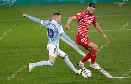 Celta Vigo's Iago Aspas (L) in action against Granada's Domingos Duarte (R) during the Spanish La Liga soccer match between Celta Vigo and Granada CF at Balaidos stadium in Vigo, Spain, 29 November 2020.