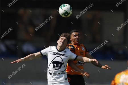 Pumas' Facundo Waller, front, and Pachuca's Luis Chavez compete for the ball during a Mexican soccer league quarterfinal second leg match at University Olympic Stadium in Mexico City