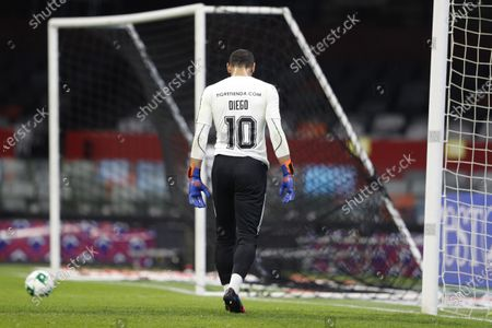 Tigres' goalkeeper Nahuel Guzman wears a jersey to honor late Diego Armando Maradona as he warms up prior to a Mexican soccer league quarterfinal second leg match against Cruz Azul during a Mexican soccer league quarterfinal second leg match at Azteca stadium in Mexico City