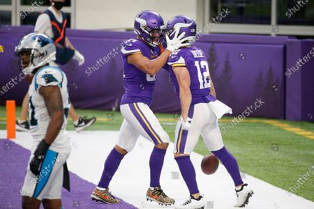 Minnesota Vikings wide receiver Chad Beebe (12) celebrates with teammate Bisi Johnson, left, after catching a 10-yard touchdown pass during the second half of an NFL football game against the Carolina Panthers, in Minneapolis. The Vikings won 28-27