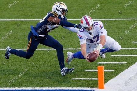 Buffalo Bills quarterback Josh Allen (17) scores a touchdown on a run against Los Angeles Chargers cornerback Michael Davis (43) during the second half of an NFL football game, in Orchard Park, N.Y