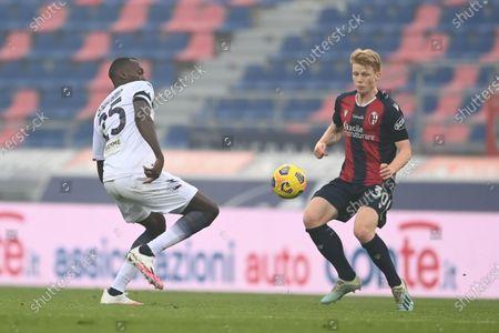 "Stock Image of Jerdy Schouten (Bologna)Simy Simeon Tochukwu Nwankwo (Crotone)           during the Italian ""Serie A"" match between Bologna 1-0 Crotone  at  Renato Dall Ara Stadium in Bologna, Italy."