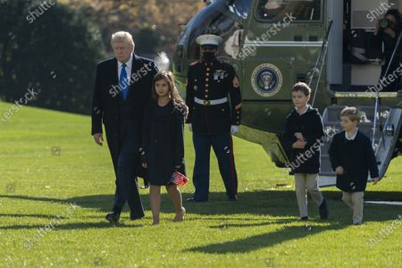 US President Donald J. Trump returns to the White House with grandchildren, Theodore, Joseph, and Arabella Kushner after spending Thanksgiving weekend at Camp David, in Washington, DC, USA, 29 November 2020.
